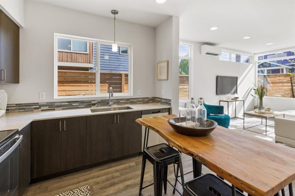 Kitchen and Living Room of 6913A at Oxbow II in Georgetown by Sage Homes Northwest