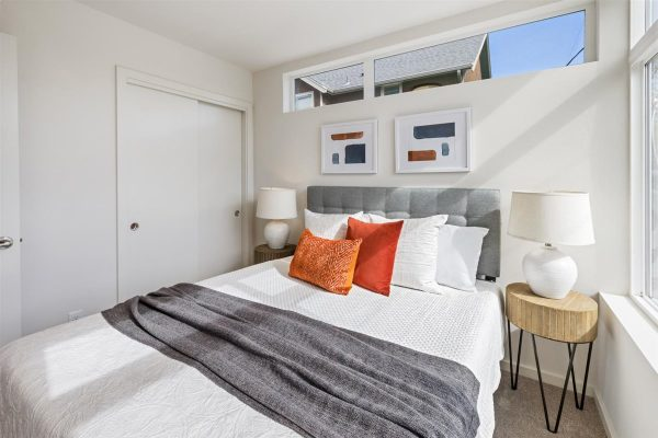 Bedroom two and closet of 6913A at Oxbow II in Georgetown by Sage Homes Northwest